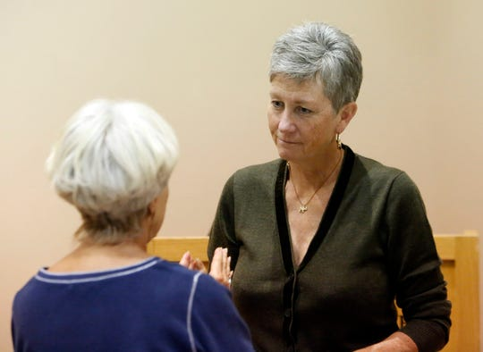 Grand Canyon National Park Superintendent Christine Lehnertz (right) speaks with a member of the public at an October 2017 event at the Museum of Northern Arizona in Flagstaff.