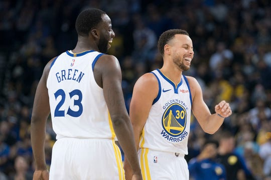 October 22, 2018; Oakland, CA, USA; Golden State Warriors forward Draymond Green (23) and guard Stephen Curry (30) laugh during the third quarter against the Phoenix Suns at Oracle Arena. Mandatory Credit: Kyle Terada-USA TODAY Sports
