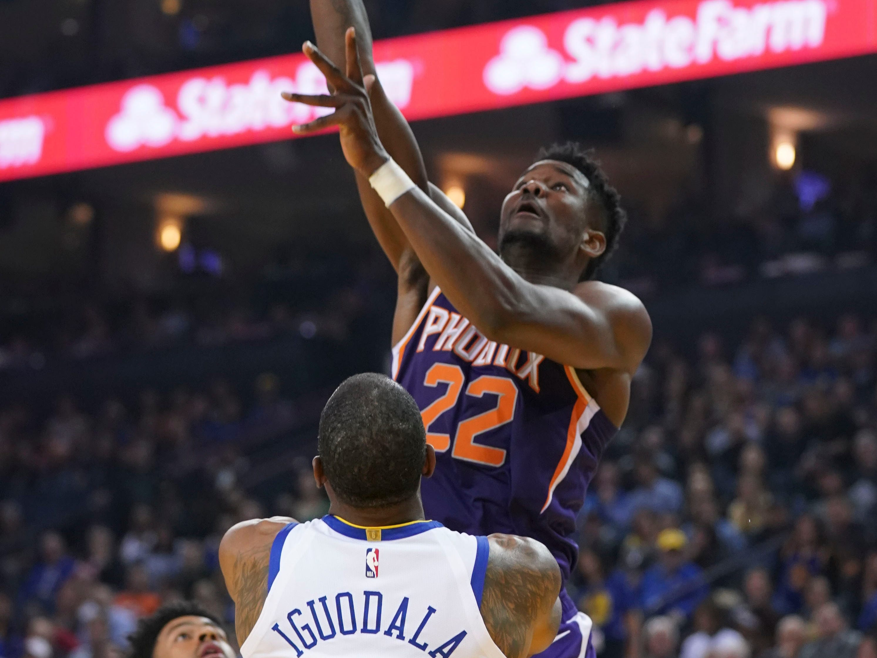 October 22, 2018; Oakland, CA, USA; Phoenix Suns center Deandre Ayton (22) shoots the basketball against Golden State Warriors guard Andre Iguodala (9) during the second quarter at Oracle Arena. Mandatory Credit: Kyle Terada-USA TODAY Sports