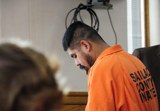 Leobardo Torres-Castillo returns to his seat in Sanilac District Court during  a brief hearing.