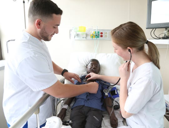 Mount Saint Mary nursing students, from left, Nick Terzulli and Shannon Christiano practice taking vitals on a training manikin on October 22, 2018.