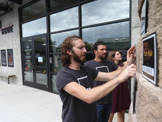 From left, Ben Williamson, Harry Lipstein and Brittany Proia place plaques in recognition of  Denizen Theatre's donors prior to opening in New Paltz on October 10, 2018.