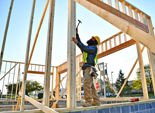 Michael Haldeman, of Red Lion, nails boards to the frame of the newest MOD Pizza is under construction at East Market Street and Memory Lane in Springettsbury Township, Tuesday, Oct. 23, 2018. Dawn J. Sagert photo