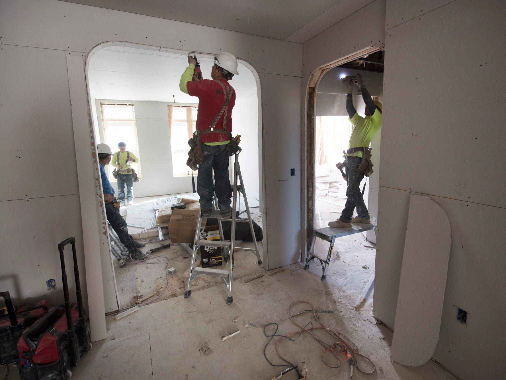 Workers install drywall at the Doll Building at 337 W. Market Street in York.