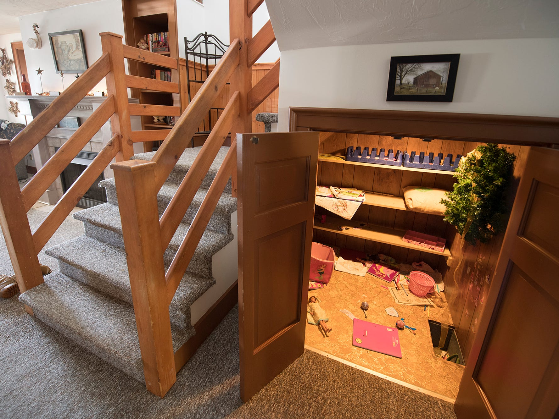 A small lighted room under the front staircase at Gray Goose Manor in Springfield Township makes the perfect child's playroom.