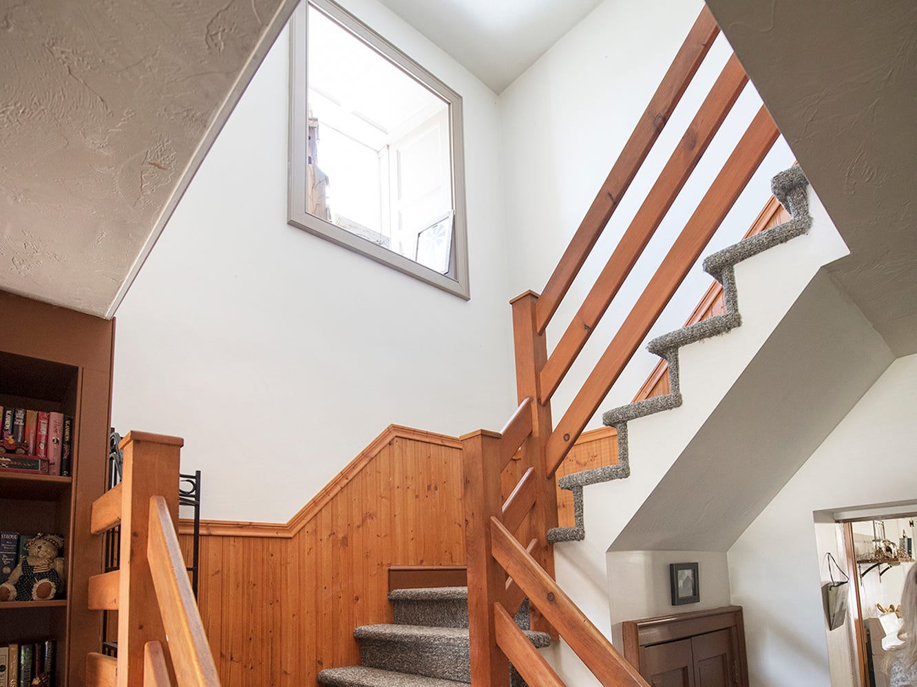 The main staircase leads to the second floor at Gray Goose Manor in Springfield Township.
