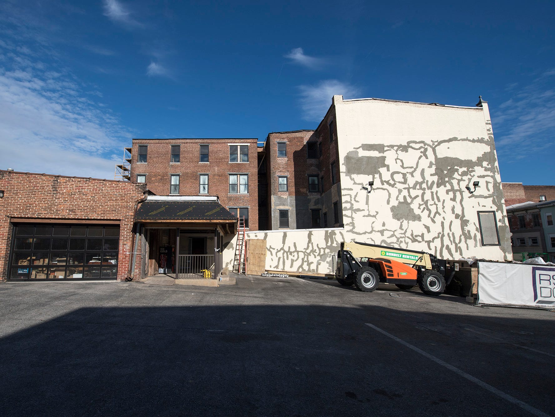 A view of the sie Doll Building at 337 W. Market with ongoing masonry repair.