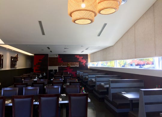 Ăn Asian Kitchen, a new Vietnamese spot in South Reno, including custom  booths in the sleeky stylish dining room.