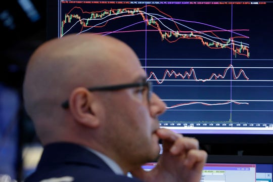 Specialist Mario Picone works at his post on the floor of the New York Stock Exchange, Tuesday, July 18, 2017. (AP Photo/Richard Drew)