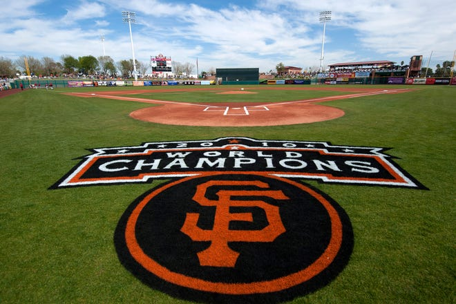 2011 file photo: A general view of the painted logo of the World Champion San Francisco Giants behind home plate before a game at Scottsdale Stadium in Scottsdale, Arizona.