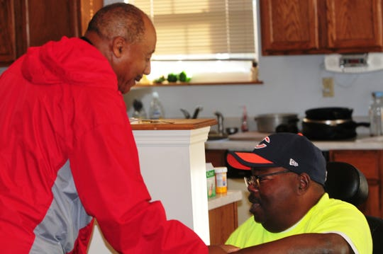 Robert Hooks, left, and Tommy Williams, have led the Richmond Youth Football League despite both overcoming several health issues.