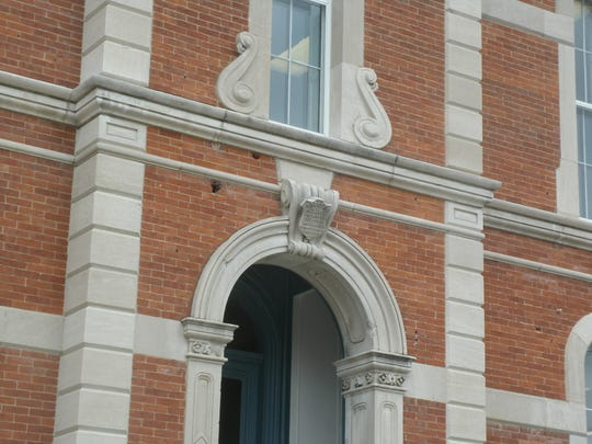 Scars from a drastic combative encounter in Wayne County history are still visible on the front of the old Sheriff's residence, now the Centerville and Center Township Public Library. The holes there were made by canon.