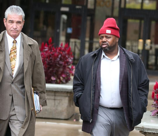 George Moses, right, leaves Federal Court in downtown Rochester Tuesday, Oct. 23, 2018.
