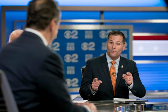 New York Gov. Andrew Cuomo, left, and Republican gubernatorial candidate Marc Molinaro, right, argue during the New York gubernatorial debate hosted by CBS 2 and WCBS Newsradio 880, Tuesday, Oct. 23, 2018, in New York.