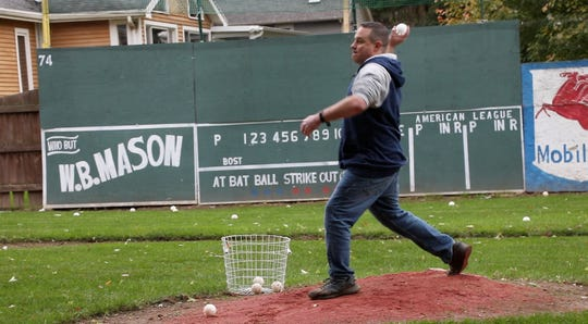 """Kevin Masters, 47, of Penfield pitches batting practice at his back yard field of dreams. """"I really don't know if it was a dream or a compulsion,'' Masters said. """"I played Wiffle Ball every day as a kid and loved it. I used to say, 'If I ever have the opportunity, I'm building a Wiffle ball stadium somewhere.' It's therapeutic.''"""