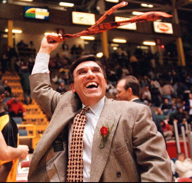 McQuaid coach Joe Marchese waves a tie at fans as he leaves the court after McQuaid's 69-55 victory over Hempstead in the Class A state final Sunday, March 16, 1997, in Glens Falls.