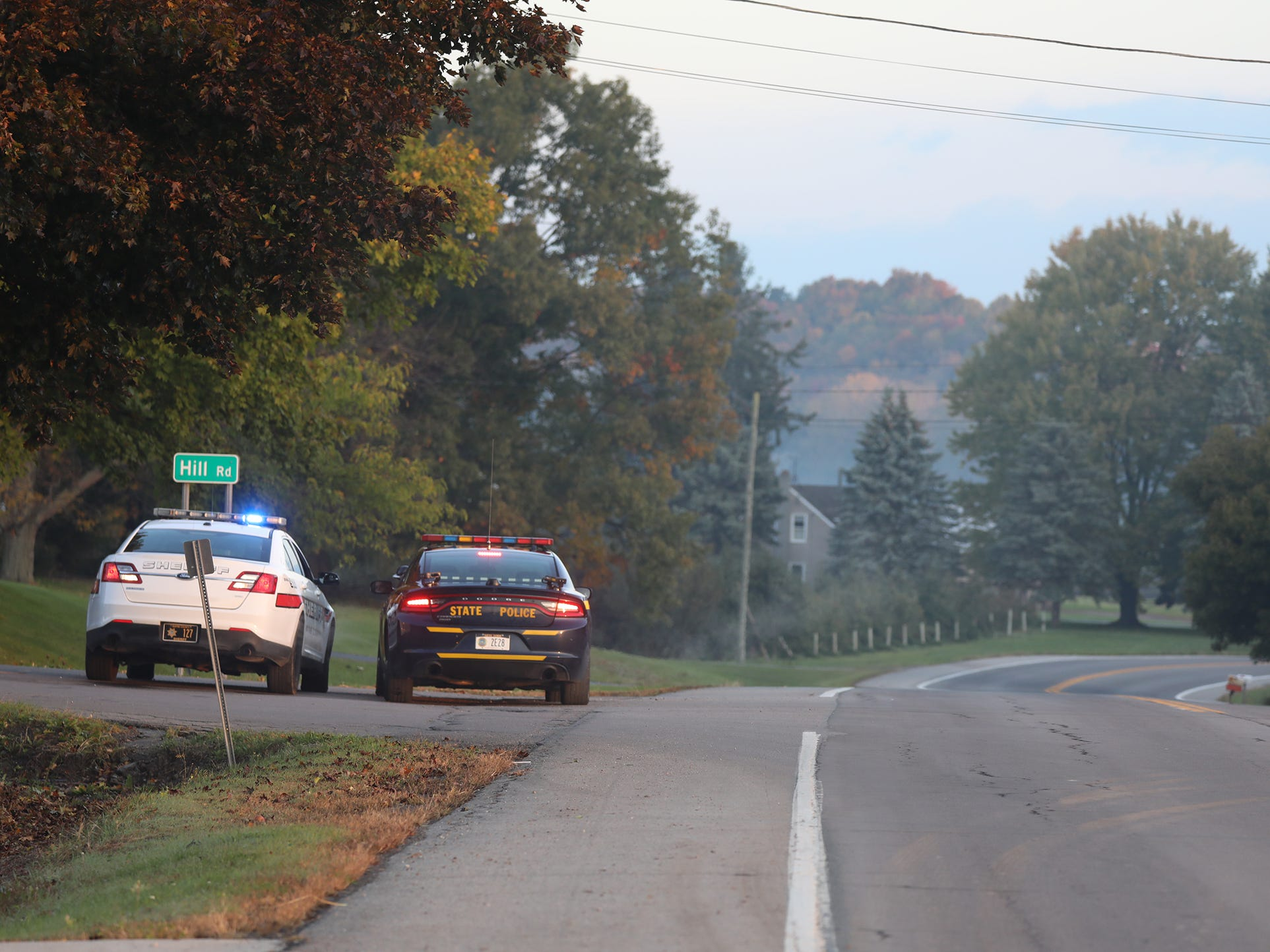 Police agencies block off different streets in Sodus.  Hill Road was one of the roads blocked.