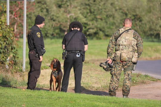 Wayne County Sheriff's Office with the assistance of other police agencies search for yesterday's shooter.  Deputies meet and confer at Newark St. at Rt. 88.