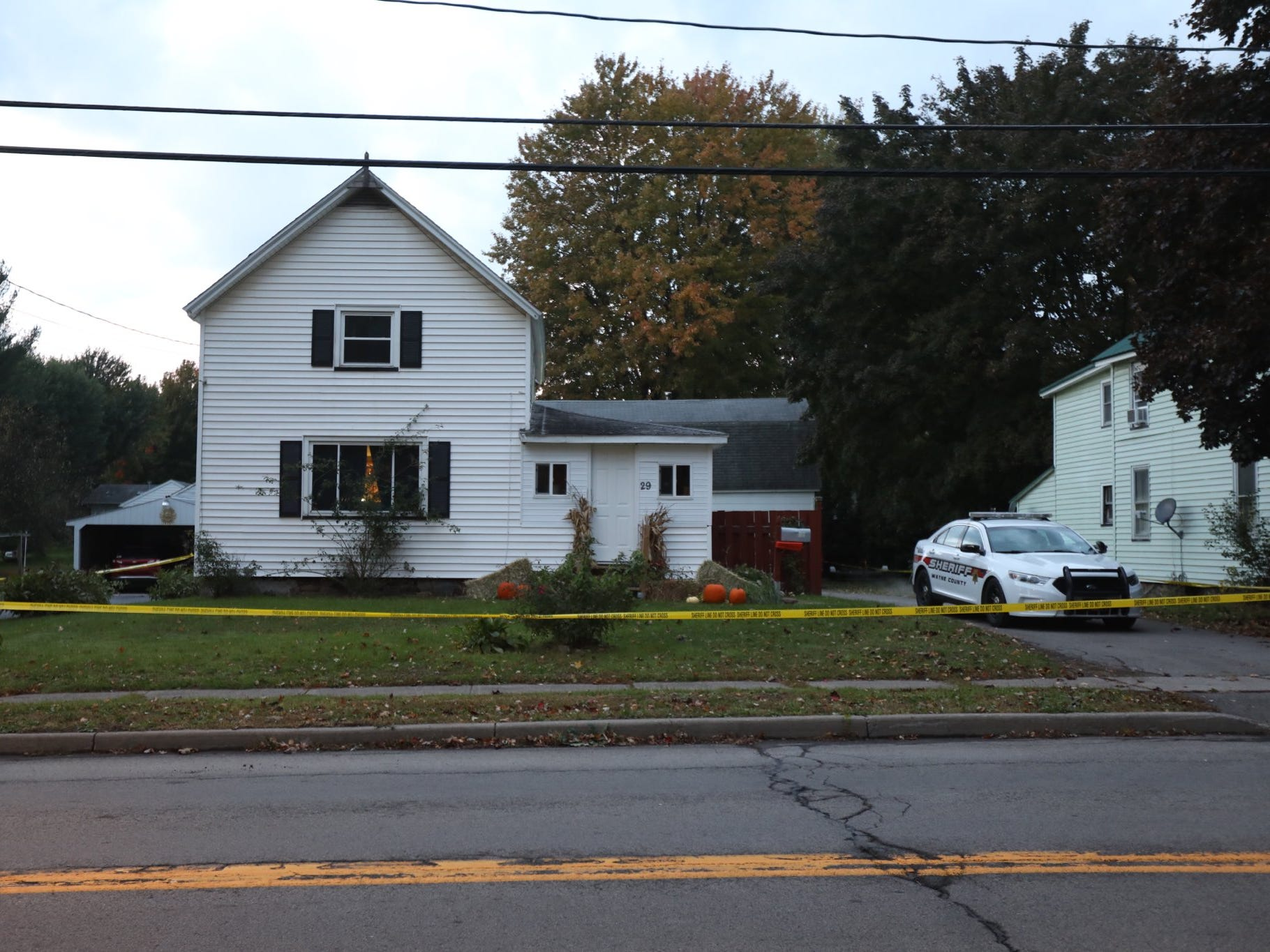 A Wayne County Sheriff's vehicle sits outside 29 Carlton St. in Sodus.