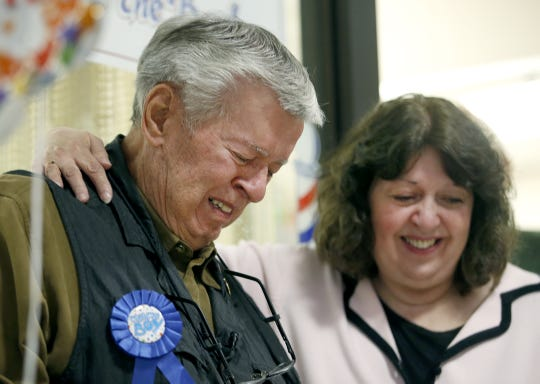 "Lou Benigni, ""Lou the Barber"", gets emotional next to his daughter LouAnn Benigni-Lynch, during a surprise 90-year-old birthday party on October 16. He still works almost full-time at his barber shop in the Metropolitan Building."