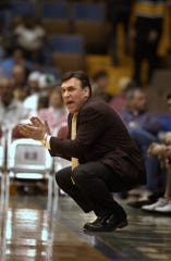 McQuaid's head coach Joe Marchese cheers on his team at the Glens Falls Civic Center in Glens Falls in 2003.