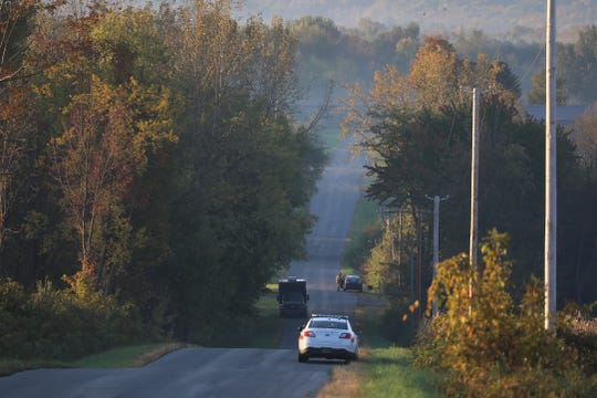 Police agencies line Allen Street as the search for the shooting suspect continues in Sodus.