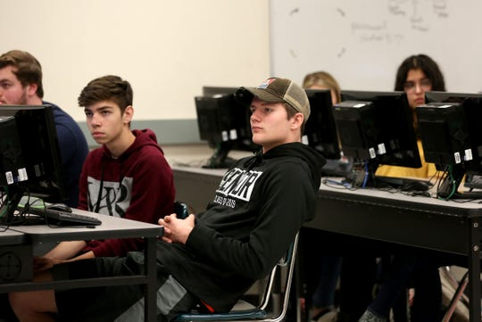 "Students in Bob Mahoney's advisory class at Dallas High School watch a video on suicide prevention focusing on the message ""real connection matters,"" on Tuesday, Oct. 23 in Dallas."