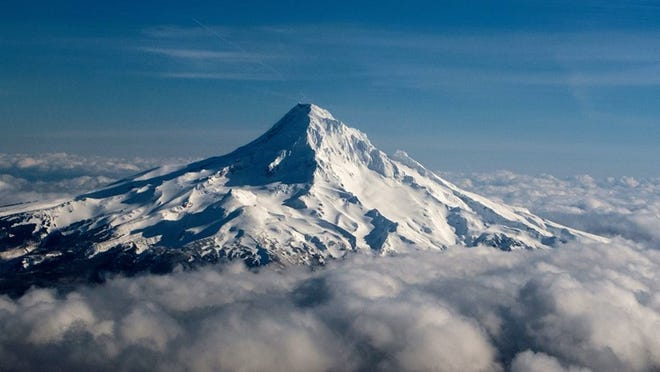 Mt. Hood rises above the clouds on March 17, 2016 near Portland, Oregon.