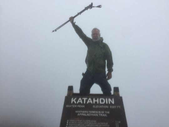 San Angelo resident John Hall stands in victory atop Mount Katahdin, the northern terminus of the Appalachian Trail in Maine, after hiking 2,190.9 miles.