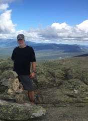 John Hall stops atop Wayah Bald in North Carolina, 120 miles into his trip up the Appalachian Trail.