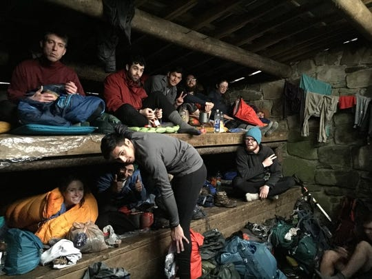 Hikers on the Appalachian Trail crowd into a shelter at Pecks Corner, North Carolina, in anticipation of temperatures falling into the 20s.