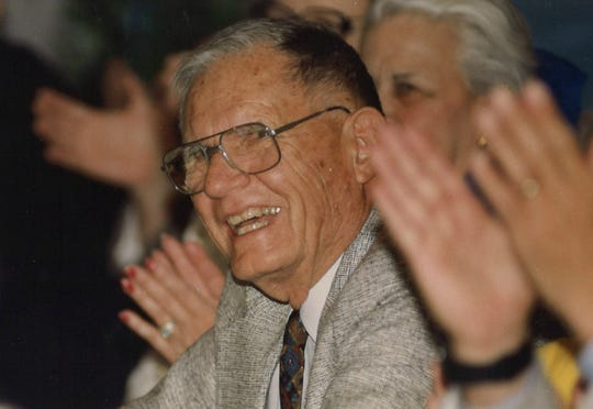 Dr. Gus Eckhardt laughs during a roast in his honor, held by Shannon Medical Center employees in August 1993 in San Angelo.
