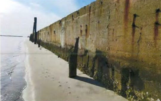 Close-up of existing concrete seawall and timber piles at Cape Charles Harbor.