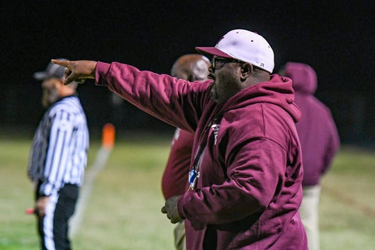 Snow Hill coach Deitrick Downing yells to his players in their away game against Washington High on Monday, Oct 22, 2018.