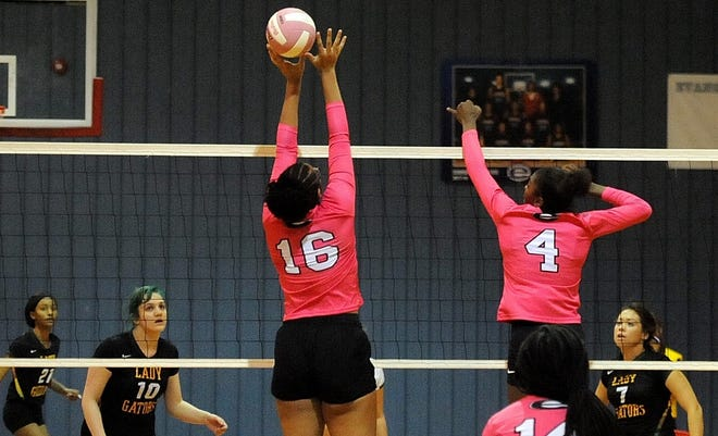 Evangel's Zoe Manning (16) and Aaronyana Wilson return a a hit by Captain Shreve's Kayla Jenkins (21), Tori Reich (10) and Erin Defee (7) during a match earlier this season.