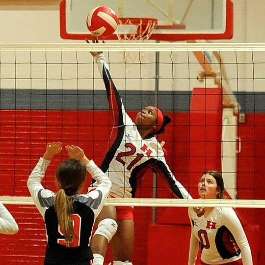 Haughton's Takaiyah Sweeney goes for a spike against Evangel earlier this season.
