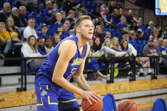 Mike Daum eyes the basket during the 3-point shooting contest at last week's Jackrabbit tip-off event at Frost Arena