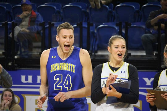Mike Daum and Tagyn Larson having a good time at the SDSU tipoff last week at Frost Arena