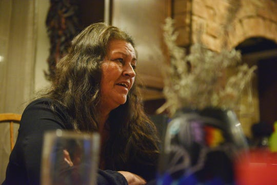 Kathy Boyd talks about Indian Health Service, IHS, with her family at the kitchen table Monday, Oct. 15, at their home in Rosebud. Kathy is the matriarch of a large family. The younger family members only remember slight details of the night she was taken to the emergency room.