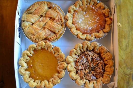 Four mini pies cost $20 are boxed up for easy transport for the holiday. You can customize your order.