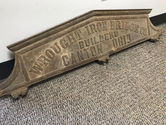The sign identifying the Wrought Iron Bridge Company as the builders of the Rough Holler Bridge was separated from the bridge in the 1930s when it was moved upriver to provide a way for the folks in the northern part of the county to cross from east to west. The sign was found by teenage brothers two decades later but sat unnoticed for more than 60 years before being reunited with the bridge this month.