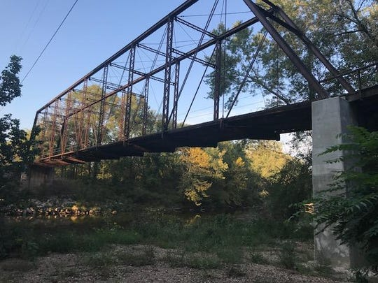 The wood plank iron truss bridge that crosses the Pomme de Terre River at Hickory County Road 281 is a beautiful example of 19th century craftsmanship. The county hopes to have the Rough Holler Bridge and another iron truss bridge south of Hermitage added to the National Registry of Historic Places.