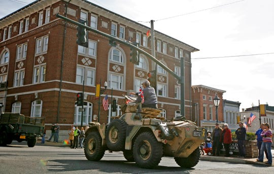 A Ferret, a British military armoured scout vehicle, rolls down the street in Staunton's Veterans Day Parade in 2012. The parade showcases many antique vehicles owned by collectors in the area.