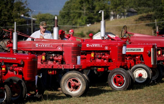Antique tractors of all years, makes and models line up at the Churchville Fall Festival in 2016. The Western Augusta Steam and Gas Exposition Company also put on a display of working tractors and equipment at the festival.