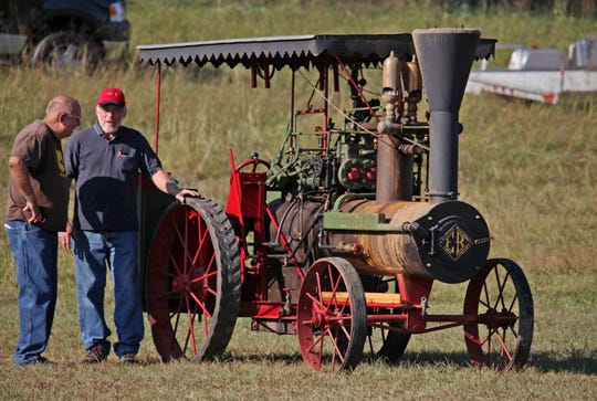 Bud Good, right, of Fort Defiance talks about his 1918 50hp Peerless steam tractor at the Churchville Fall Festival in 2016. Good pieced together the steam tractor from parts he scrounged at flea markets in Pennsylvania in the 1970s and ended up hand-building the boiler on it. The Western Augusta Steam and Gas Exposition Company puts on a display of the working machines.