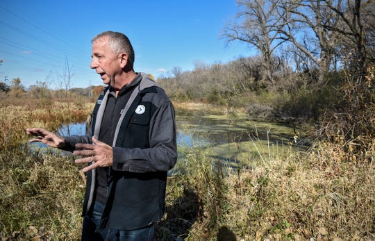 St. Cloud Mayor Dave Kleis pauses Tuesday, Oct. 23, near a pond on land the city might purchase in the coming months.