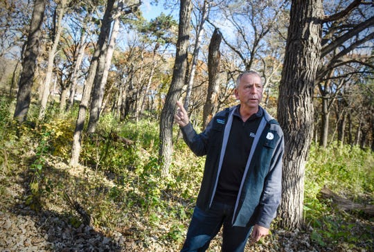 St. Cloud Mayor Dave Kleis talks about plans for the new Talahi Woods expansion to Riverside Park during a tour Tuesday, Oct. 23.