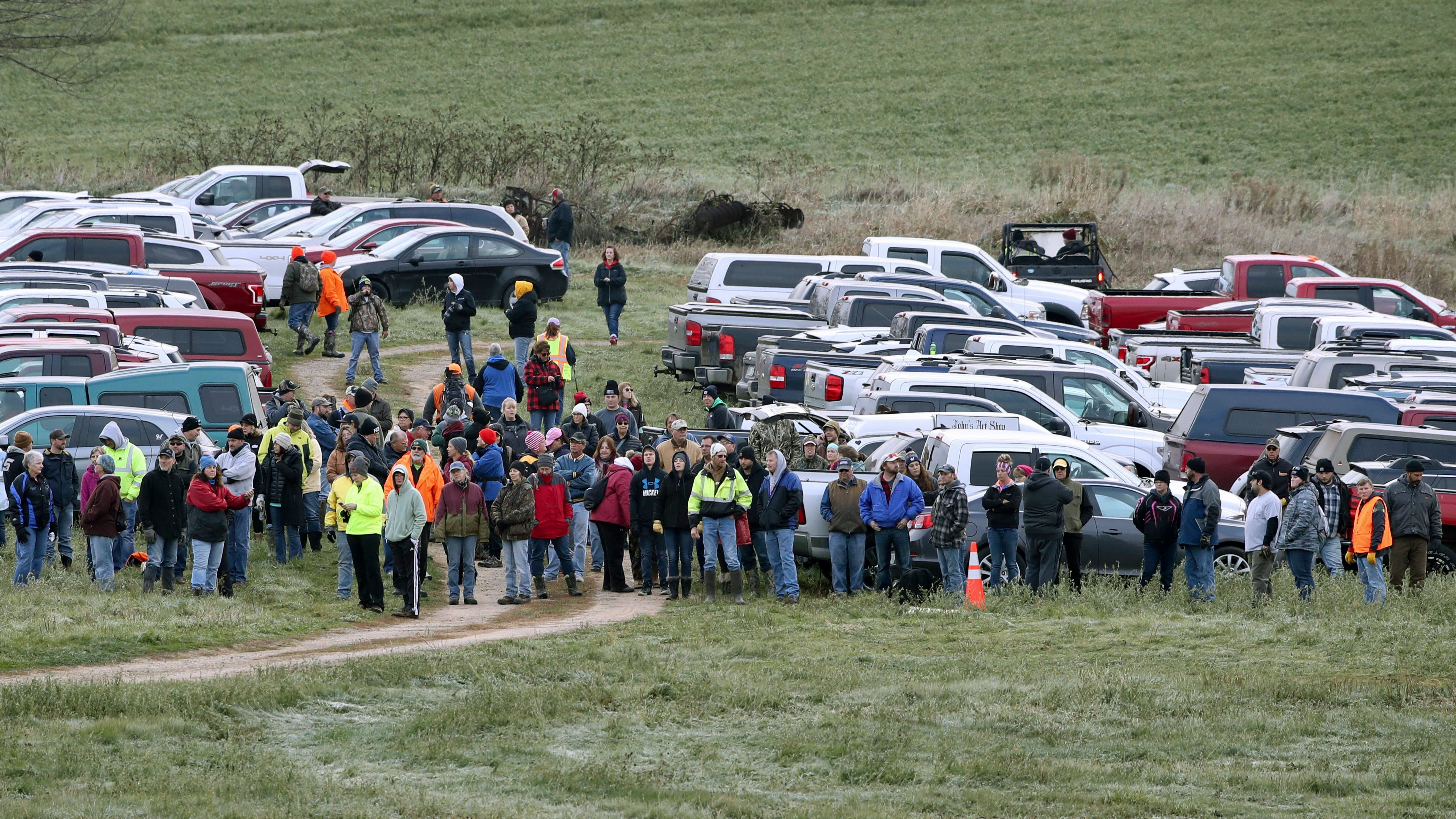 Hundreds of volunteers gather Tuesday, Oct. 23, 2018, in Barron, Wis., to assist in the search for Jayme Closs, a missing teenage Wisconsin girl, whose parents were killed in the family's home. Jayme has been missing since Oct. 15, when deputies responding to a 911 call found that someone had broken into the family's home in Barron and gunned down James and Denise Closs.