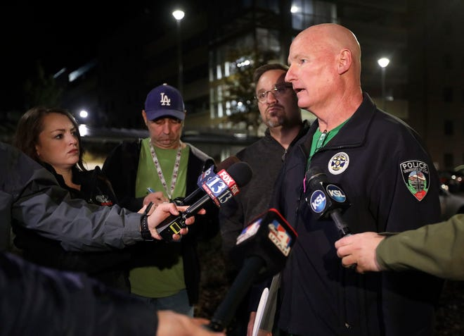 "University of Utah Police Lt. Brian Wahlin talks to members of the media outside of the South Medical Tower on the University of Utah campus during a search for a man they say shot and killed a University of Utah student outside of a dormitory on campus, the Salt Lake Tribune reported Monday, Oct. 22, 2018, in Salt Lake City. The female student's body was found in a car near the medical towers, Wahlin said. The man they are searching for and the student had ""a previous relationship,"" Wahlin said. (Kristin Murphy//The Deseret News via AP)"