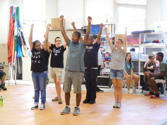 """Leon United students hit a high """"V"""" during their dance routine."""